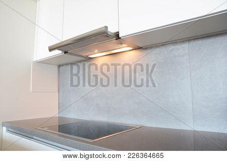 Close up on modern air exhauster kitchen fan or Range Hood. Stainless Steel Chimney Hood. Island Hoods. Cooker Hood stock photo