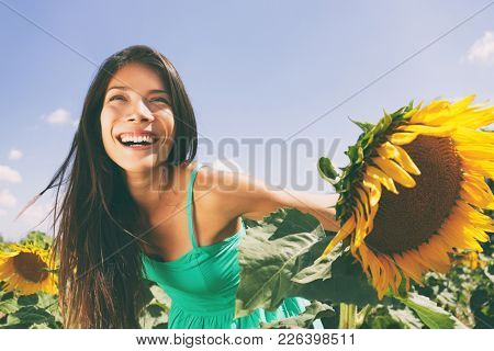 Spring flower field nature woman happy allergy-free breathing clean air in summer sunshine. Pollen a