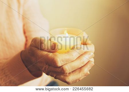 Elderly woman, wrinkled hand w/ clearly visible veins, palms lay flat on the table. Old lady arms, freckles. Isolated white background, close up, overhead, copy space. stock photo