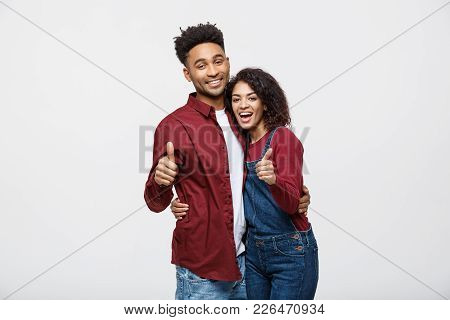 Portrait of attractive African american couple showing thumb up over white studio background stock photo