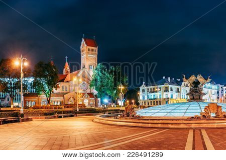 Minsk, Belarus. Night View Church Of Saints Simon And Helen Or Red Church In Independence Square. This Neo-Romanesque Church Built During 1905-1910 stock photo