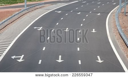Curve of a big empty new highway with three lanes stock photo