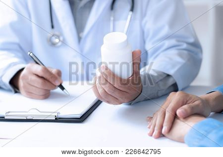 madicine doctor giving pills to patient at a hospital / clinic stock photo
