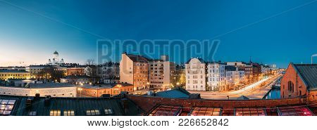 Helsinki, Finland. Panoramic View Of Helsinki Cathedral, Pohjoisranta Street And Redone Old Building For Banquet Hall In Evening Illuminations. stock photo