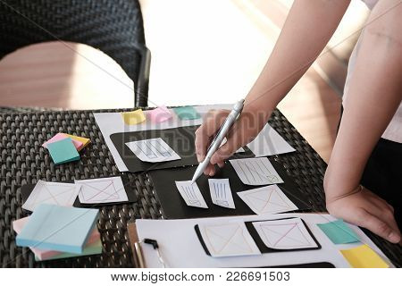 user experience (UX) designer designing web on smart phone layout. UI planning mobile application. developer work with business prototype stock photo