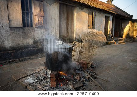 Big pot to cook Chung cake outdoor, square glutinous rice cake, Vietnamese lunar new year food stock photo
