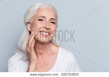 Charming, Pretty, Old Woman Touching Her Perfect Soft Face Skin With Fingers, Smiling At Camera Over
