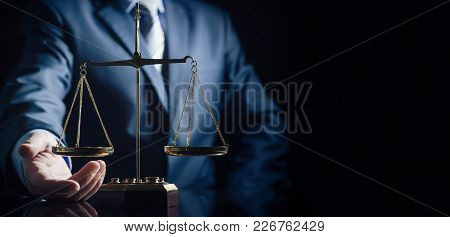 Weight scale of justice, lawyer in background. justice law lawyer attorney scale weight court authority concept stock photo