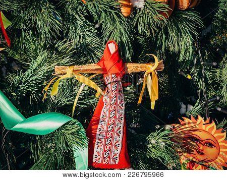 Rag Dolls on christmas tree on folk Slavic pagan holiday Maslenitsa of the end of winter stock photo