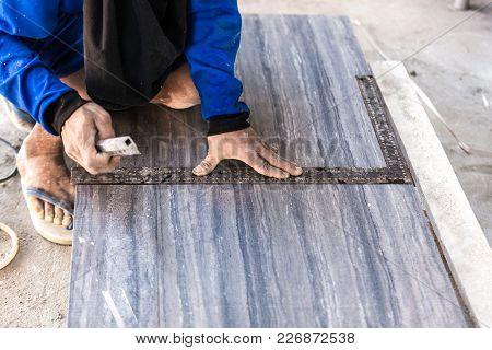 Industrial construction men worker granito tiler builder on floor stock photo
