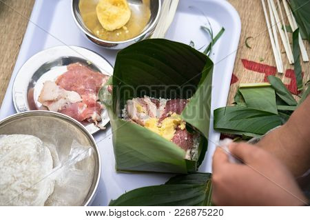 Making Chung cake by hands closeup, Chung cake is the most important traditional Vietnamese lunar New Year (Tet) food. stock photo
