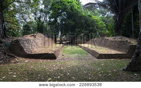 An ancient mayan ball court sits at the ruins of Nim Li Punit in southern Belize. stock photo
