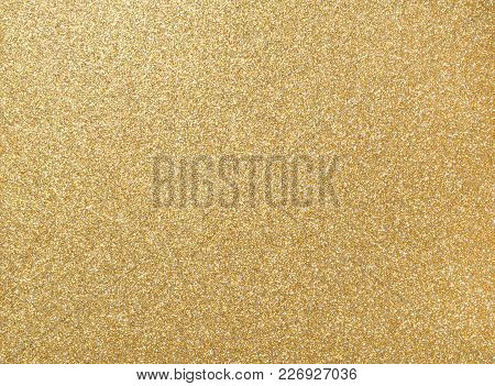 Glister Grain Of Gold On Rough Golden Plate, Closeup Photo On Rough Golden Plate Surface Show A Deta