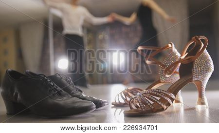 Blurred Professional Man And Woman Dancing Latin Dance In Costumes In Studio, Two Pairs Ballroom Sho