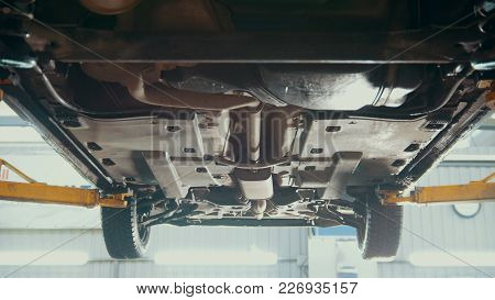 Car service - bottom of the car - the suspension of SUV, slider shot stock photo