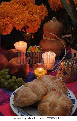 Offering as part of the celebration of the day of the dead in Mexico with bread stock photo