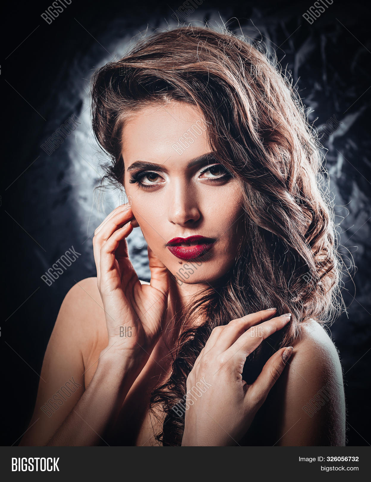 Glamorous Young Woman With Evening Makeup. Isolated