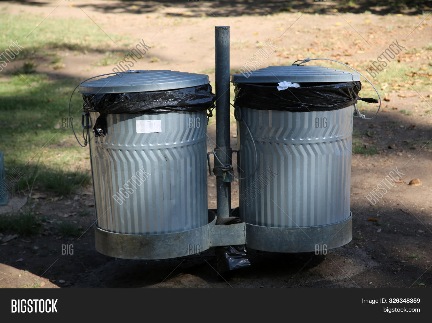 aluminum,basket,bin,bucket,can,clean,conservation,container,discard,disposal,dispose,dump,dumping,dumpster,dustbin,ecological,ecology,empty,environment,environmental,full,garbage,garbage can,industrial,isolated,junk,lid,litter,metal,metallic,municipal,nature,object,outdoor,paper,plastic,pollution,recycle,recycling,refuse,rubbish,silver,steel,trash,trash can,urban,waste,wastebasket,wastepaper