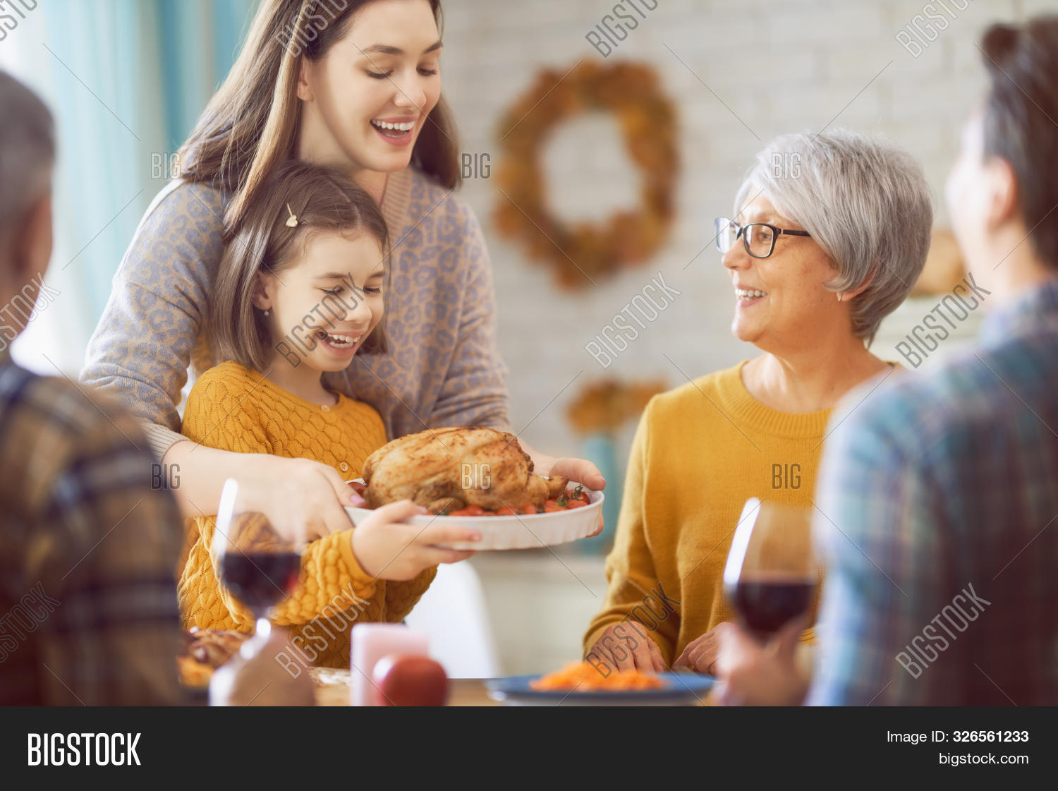 adult,blessing,candles,caucasian,celebration,cheerful,children,crops,day,dining,dinner,drinks,eating,enjoyment,event,fall,family,father,feast,food,friend,fun,girl,greetings,group,happiness,happy,holiday,kid,meals,men,mother,parents,party,people,pie,prayer,pumpkin,relative,senior,table,thankful,thanksgiving,together,togetherness,tradition,turkey,women,young