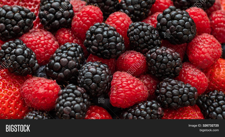 Berry Background. Blackberries, Raspberries And Strawberries Closeup, Macro. Food Background. Sweet