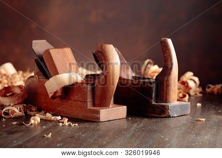 Old wooden jointers and shaving on wooden table. Selective focus. stock photo