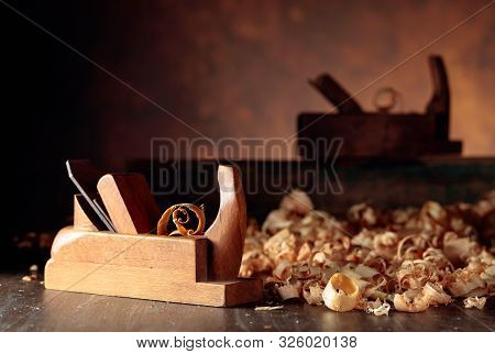 Old wooden jointer and shaving on wooden table. Selective focus. stock photo