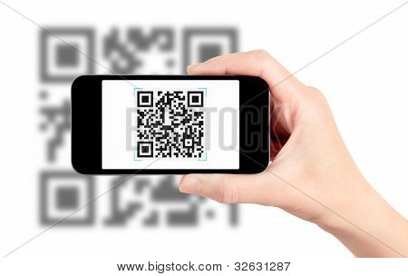 Scanning QR code with mobile smart phone. Isolated on white. stock photo
