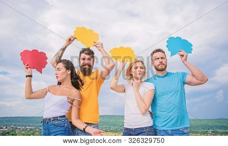 Romantic relations. Difference between men and women. Thoughts of different sex. Bearded hipster and girl with speech bubbles copy space. Diversity concept. Relations issues. Couple in love relations stock photo