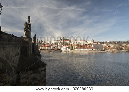 Karluv most bridge, Vltava river, Mala Strana and Hradcany with Prazsky hrad castle in Praha city in Czech republic during nice early spring day stock photo