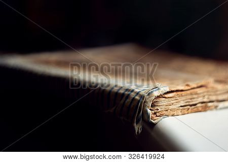macro closed old antique bible book with sticky cover on a dark background close-up stock photo
