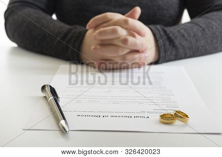 Divorce concept. Hands of wife, husband signing decree of divorce, canceling marriage, legal separation documents. stock photo