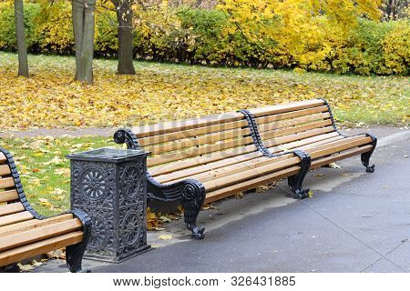 City park in the fall. Benches in the autumn park. Autumn landscape. Warm peaceful day in the autumn park. Nobody here. Autumn card. stock photo