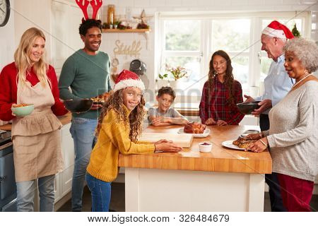 Multi-Generation Family In Kitchen Helping To Prepare Christmas Meal Together stock photo