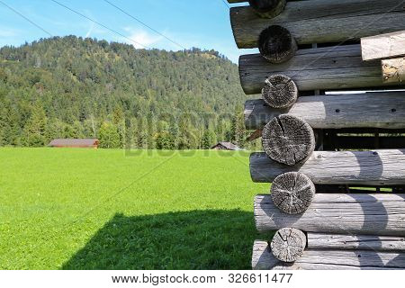 Log cabin home - Wall of house from logs stock photo