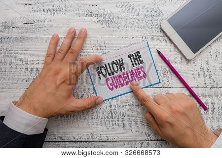 Writing note showing Follow The Guidelines. Business photo showcasing Manual of Style Follow a Specified Rule Accordingly. stock photo