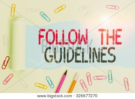 Conceptual hand writing showing Follow The Guidelines. Business photo text Manual of Style Follow a Specified Rule Accordingly. stock photo