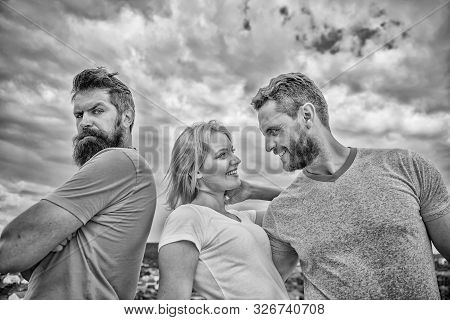 Offended partner still suffers. Couple and rejected partner. How get over breakup for guys. Ruined relationships. Psychology of breakup. Girl stand between two men. What do when you feel rejected stock photo
