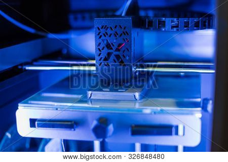 Automatic three dimensional 3D printer machine printing plastic model at modern technology exhibition. 3D printing, additive technologies, 4.0 industrial revolution and futuristic concept stock photo