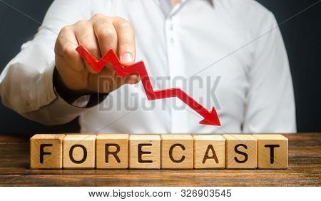Man holds red arrow down over word Forecast. A budget shortage, recession economy, unprofitable company. Prediction of profit fall, value of assets and market conditions. reduction income and earnings stock photo