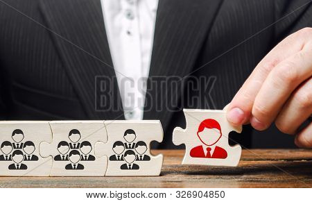A businessman appoints a leader to the head of the team. Creation of an effective teams of specialists for the implementation of a new project. HR recruiting. Management appointment. nepotism stock photo
