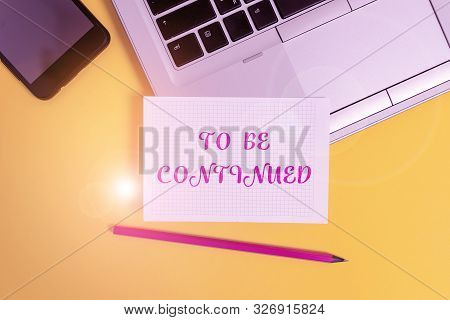 Text sign showing To Be Continued. Conceptual photo indicate that the story continues in the next episode Metallic laptop pencil squared paper sheet smartphone colored background. stock photo