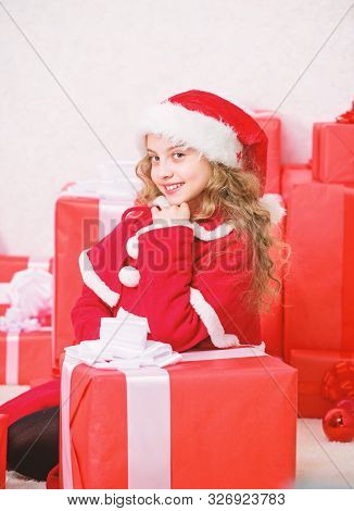 Kid happy with christmas present. Santa bring her gift. Unpacking christmas gift. Happy new year concept. Winter holiday tradition. Girl celebrate christmas open gift box. Opening christmas gift stock photo
