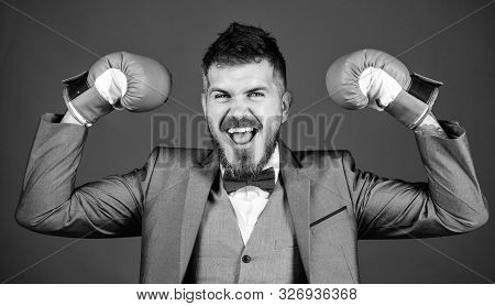 Successful businessman. Criminal defense lawyer planning out strategies. Businessman wear boxing gloves. Best criminal defense lawyer strategies. Tactics proven to work. Attack and defense concept stock photo