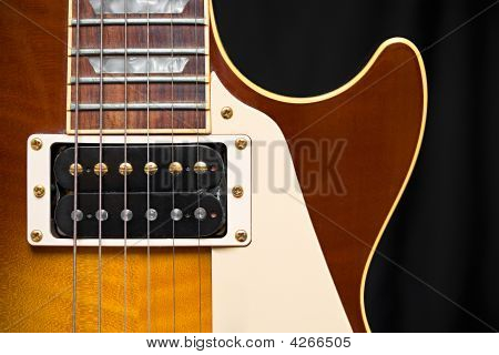 Electric Guitar with Tobacco Honey Sunburst Finish pickup frets and pick guard with room for text stock photo