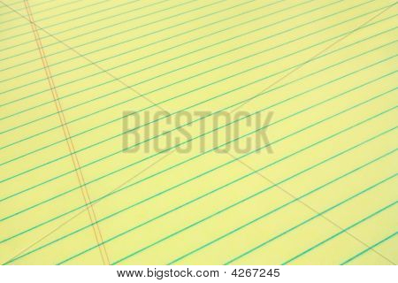 Legal pad of yellow paper for your business message wide angle view stock photo