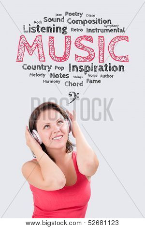 Smiling young woman is listening to music under the emotions bubble through Bluetooth headphones stock photo