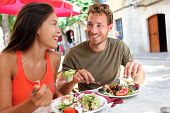 Restaurant vacationers couple eating at open air bistro. Summer travel individuals eating solid sust