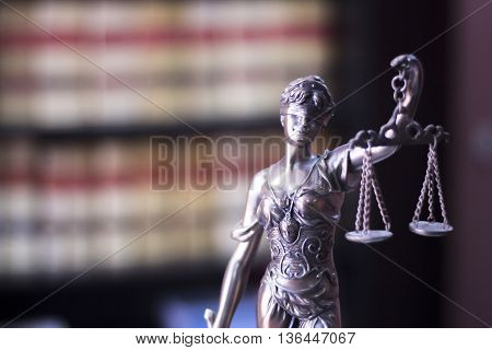 Legal blind justice Themis metal statue with scales in chain in law firm offices photo. stock photo