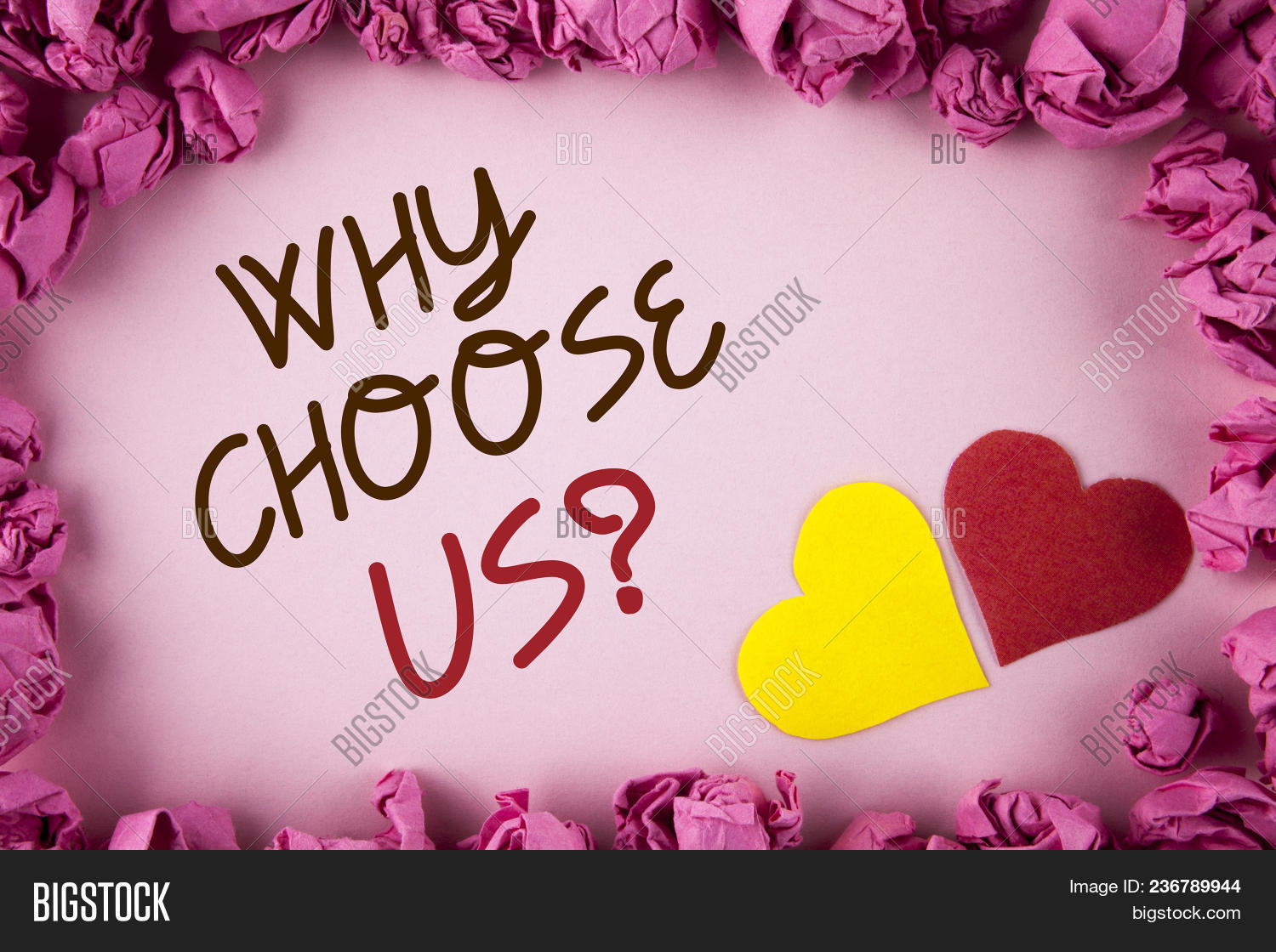 Word writing text Why Choose Us Question. Business concept for Reasons to select our Services Products or Offers written plain background within Pink Paper Balls Hearts next to it.