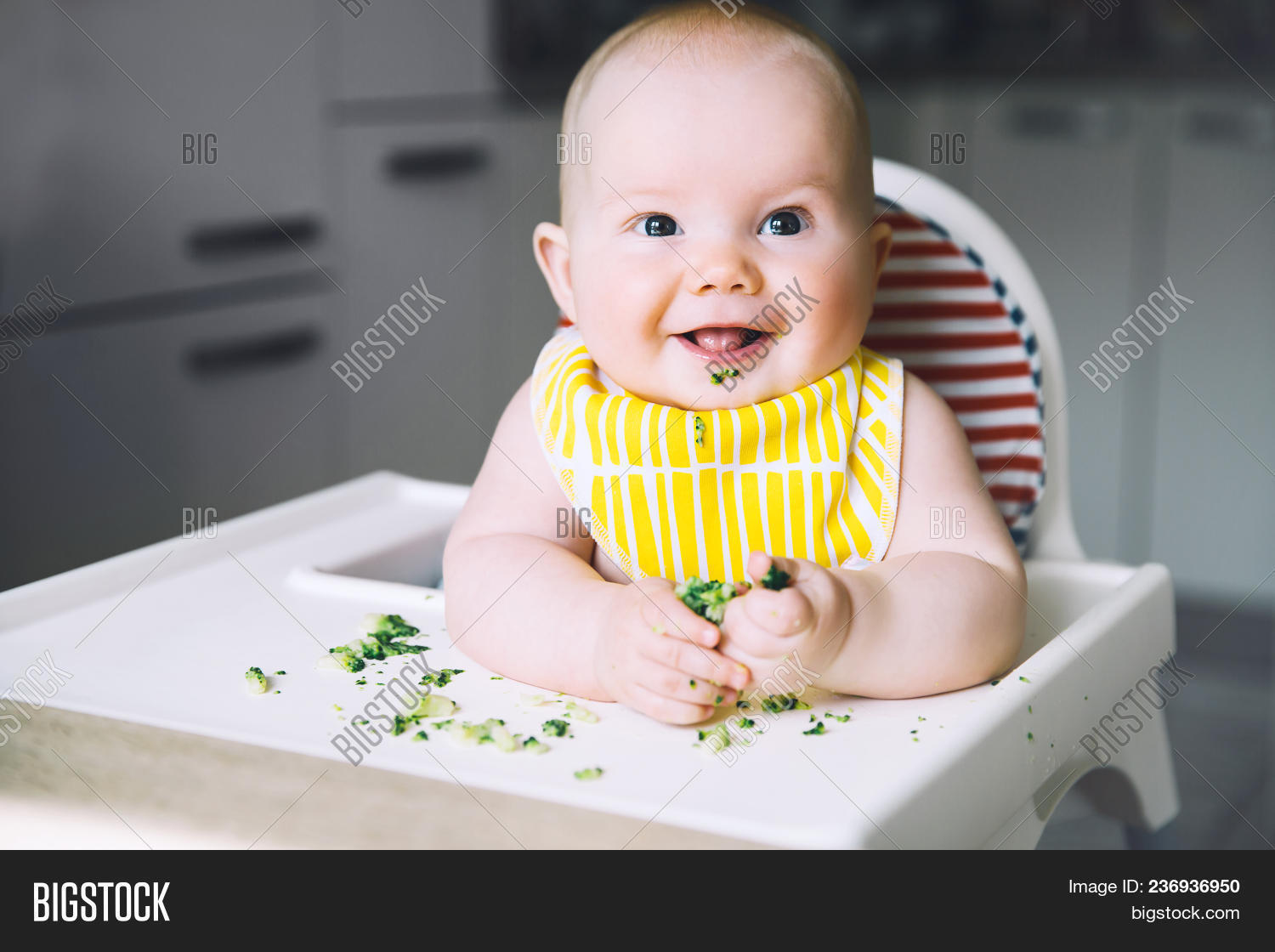 Baby,Bowl,Breakfast,Care,Chair,Chaos,Cheerful,Child,Dinner,Family,Food,Fruit,Healthy,Holding,Hungry,Indoors,Lunch,Making,Meal,Messy,Mother,Parent,Portrait,Pouring,Smiling,Solid,Spilling,Spoon,Table,Teaspoon,adorable,broccoli,chew,cutest,daily,eat,feed,first,happy,high,himself,kid,little,mush,nutrition,puree,refuses,taste,try,vegetables